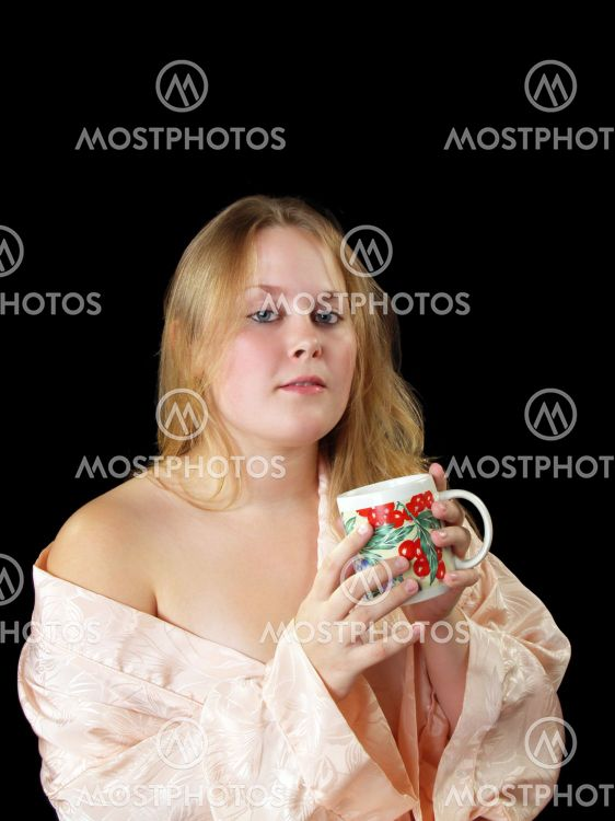 Young plump woman in robe with coffee cup