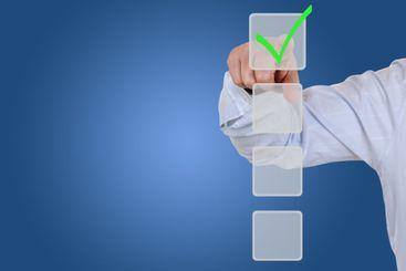 Businessman choosing a checkbox choice for business,...