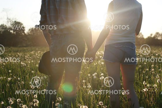 Cute couple on a walk by the countryside