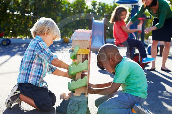 Two Boys Playing With Toy In Playground