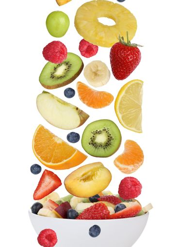 Fruit salad with fruits like apples, oranges, banana and...