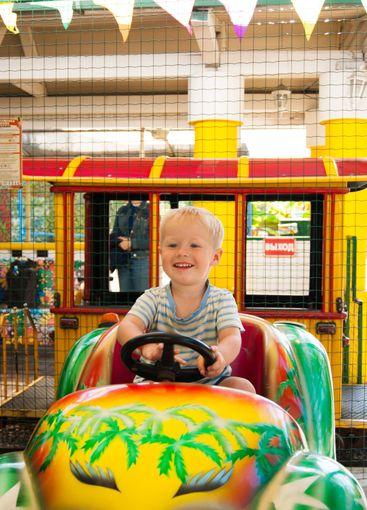 A very joyful and happy little blond boy of three years...
