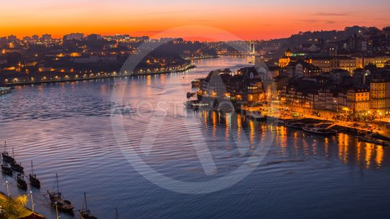 Night view of the Douro river and Ribeiro in Porto,...