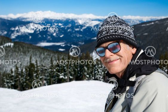 Man skier in mountains.