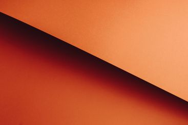 Colorful orange flat lay background with sharp layers...