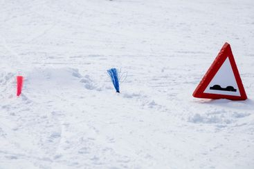 Jump in a snowy piste track.