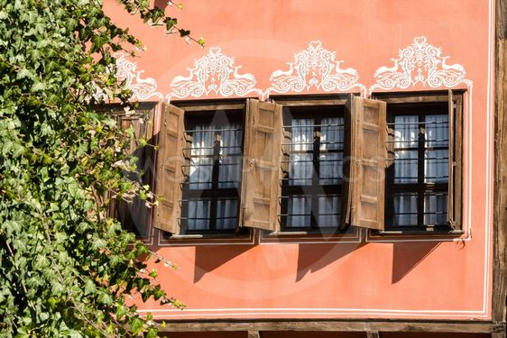 Windows with wooden shutters in the old Plovdiv