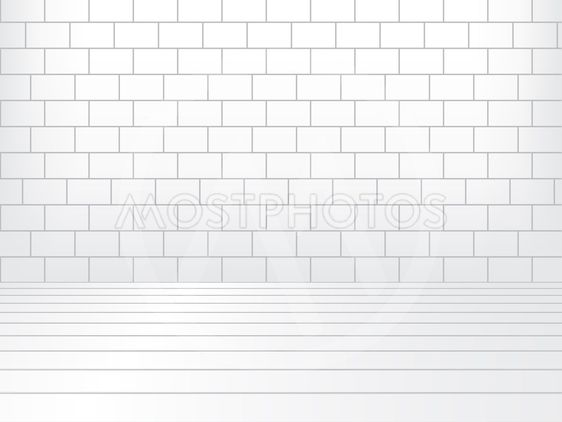 White room with brick wall and wooden floor