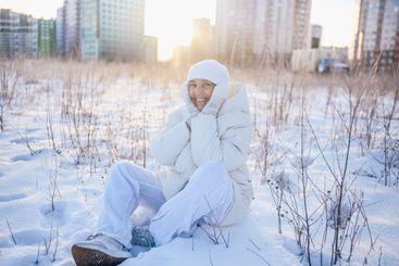 Happy elderly senior mature woman in white warm outwear...
