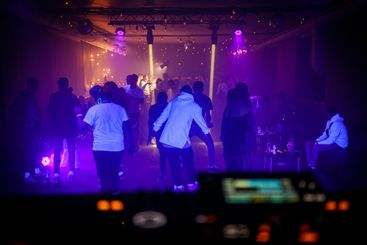 People dance on the dance floor at a techno night club...