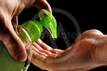 washing hands with liquid soap