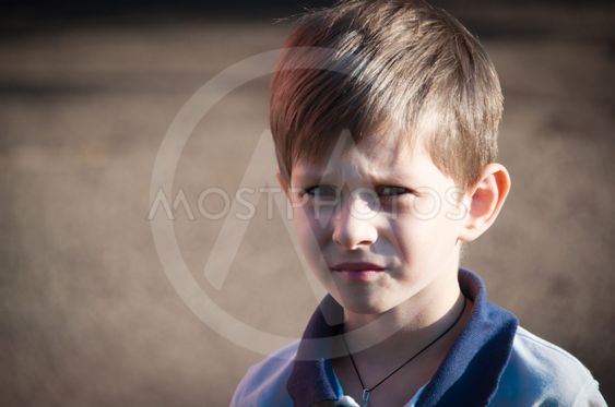 Portrait of the  boy with a sad look