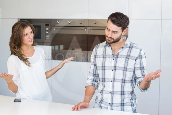 Woman explaining man by table