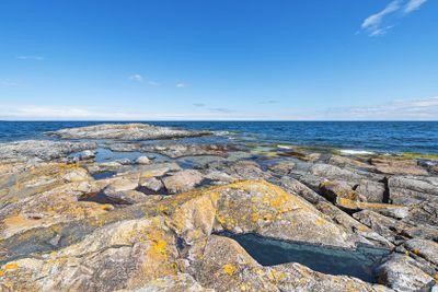 Coastal scene with rocks, seascape with horizon