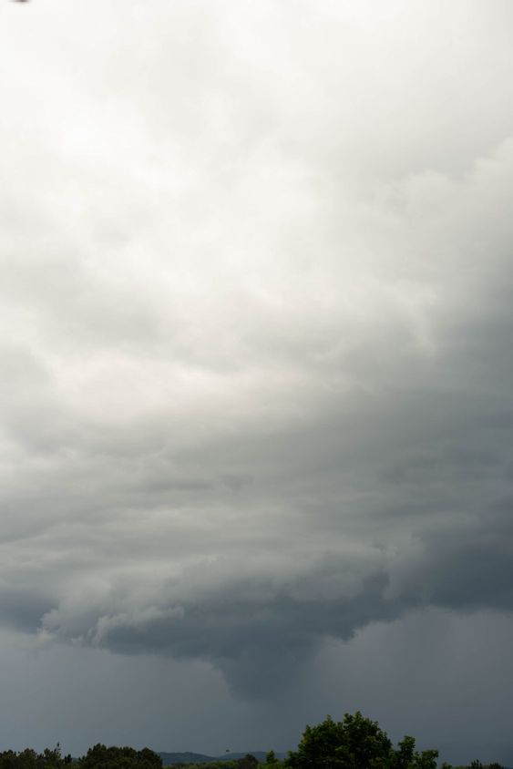 gigantic storm cloud formation in the gray sky