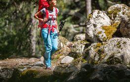 Pretty, young female hiker walking through a splendid...