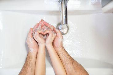 heart. dad teaches daughter thorough washing hands