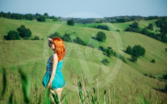 Young woman enjoying a view of the hill