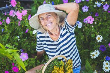 Happy smiling elderly senior woman having fun posing in...