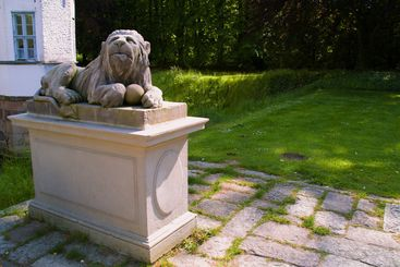 Stone lion on a pedestal