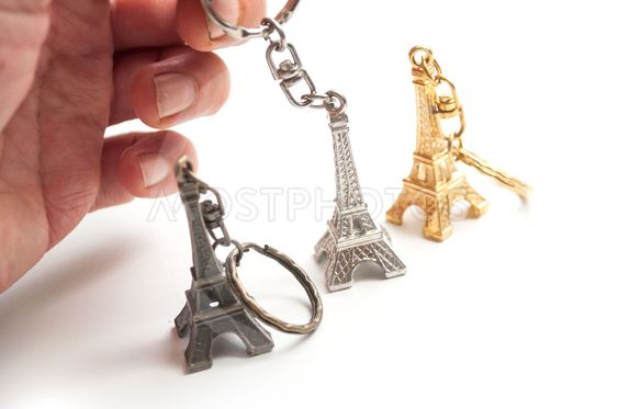 metallic Eiffel tower miniature in hand  on...
