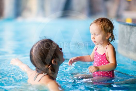 Mother and daughter at swimming pool