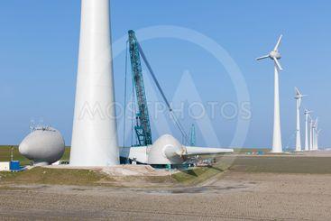 Dutch farmland with construction site ner wind turbines