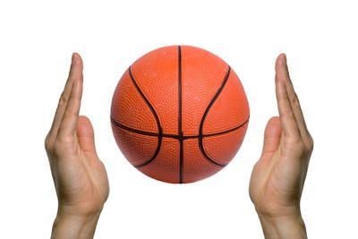 Basketball between two hands