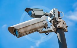 Double Security CCTV camera under blue sky