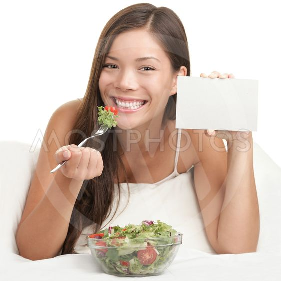 Woman Eating Salad showing copy space sign