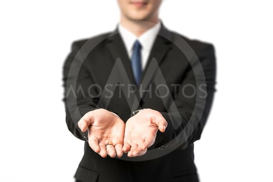 Businessman stretching out both hands