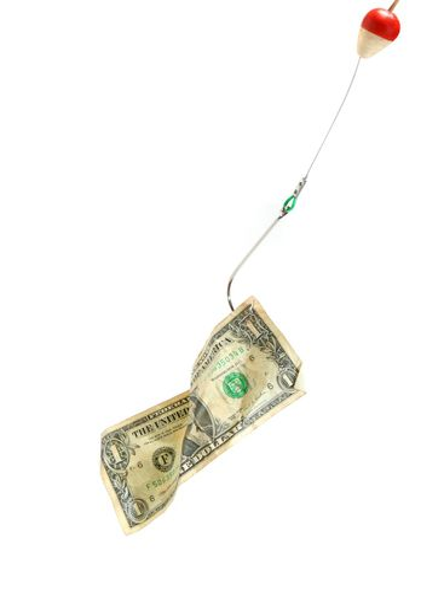 Conceptual. Dollar bill in a hook