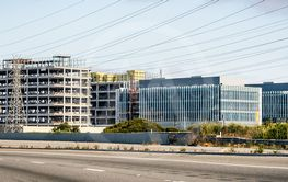 Large office buildings under construction next to...