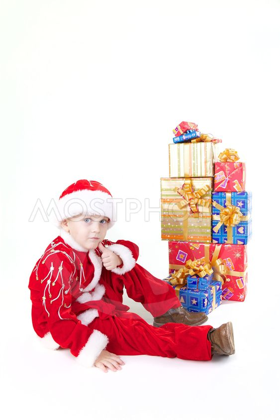 Boy in christmas clothes with presents