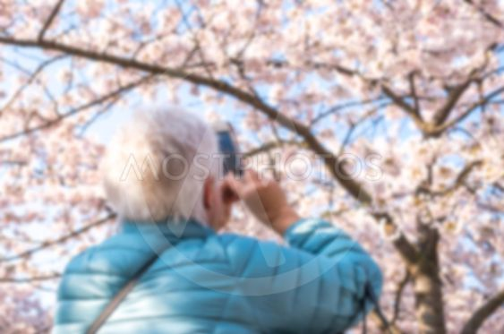 Abstract defocused and blurred of an elderly woman...