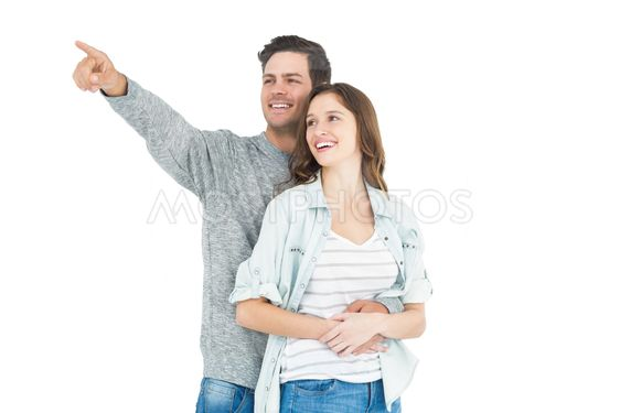 Couple embracing and pointing up
