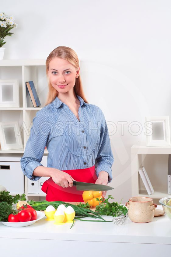 portrait of a woman cooking vegetables