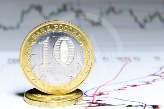 Russian coin against the background of the financial charts