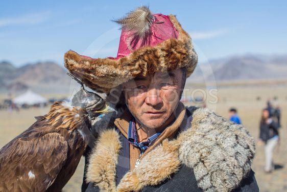 Kazakh Golden Eagle Hunter at traditional clothing,...