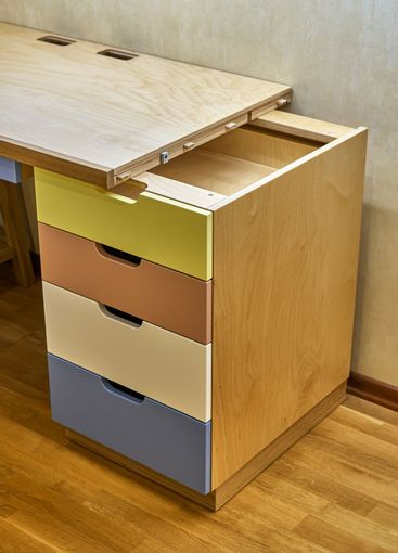 Plywood desk with multi color drawers during assembly