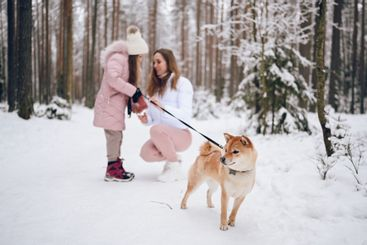 Happy family young mother and little cute girl in pink...