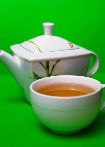 Teapot with a cup of tea