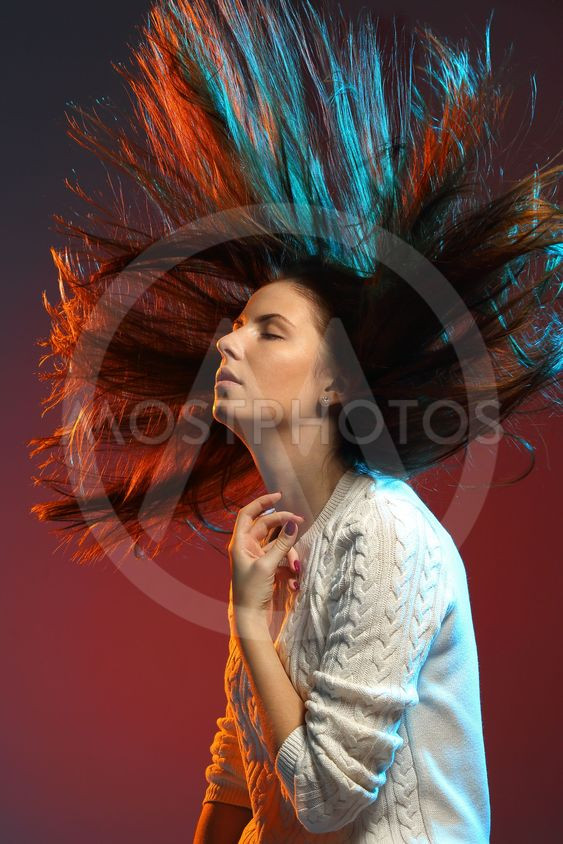 Trendy hairstyle concept. Young woman with colorful dyed...