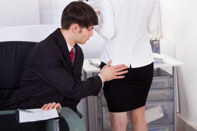Pervert Businessman Touching Female Colleague's Buttock