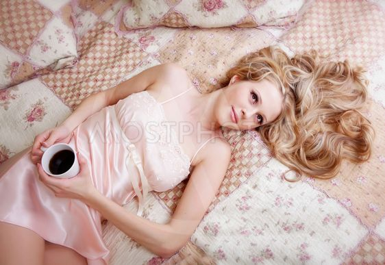 Girl in nightgown with cofee
