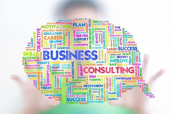 Business man with business word cloud on the screen,...