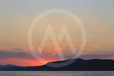 Sea view with sunset over the mountains