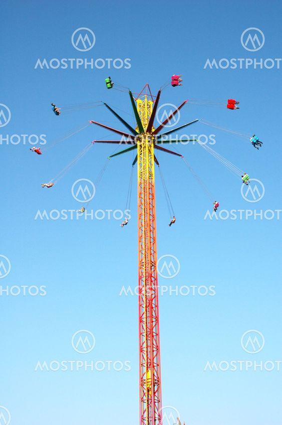 Swinging Ride At Amusement Park
