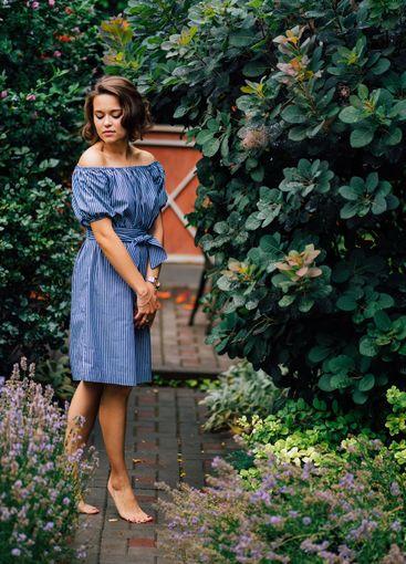 beautiful brunette girl barefoot walking in summer...
