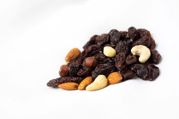 A healthy snack of a mixture of nuts and raisins